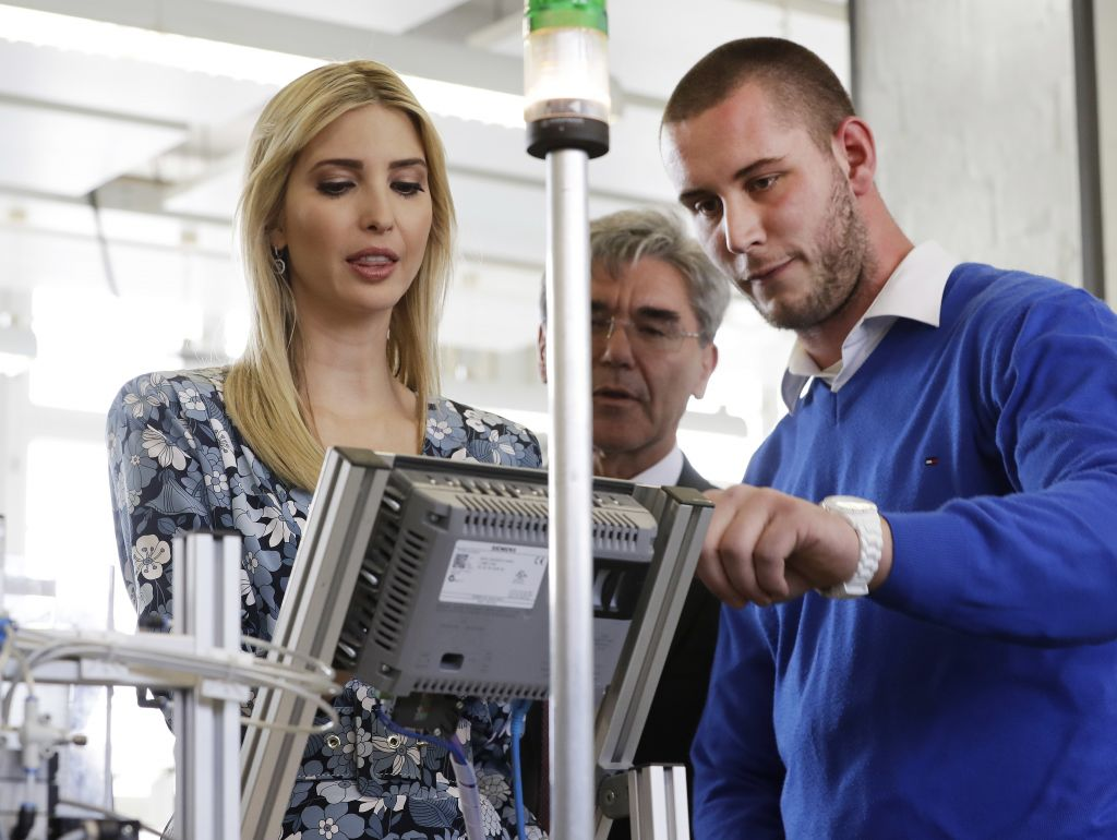 Ivanka Trump, daughter and adviser of US President Donald Trump, talks to a trainee when visiting the Siemens Technik Akademie after she participated in the W20 Summit in Berlin Tuesday, April 25, 2017. (AP Photo/Michael Sohn, pool)
