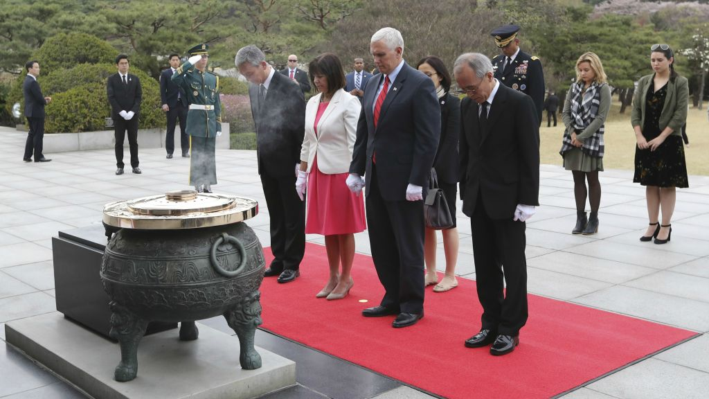 US Vice President Mike Pence, second right in front, pays a silent tribute with his wife Karen Pence, front row second from left, and his daughters Charlotte, second from right, Audrey, right, at the Seoul National Cemetery in Seoul, South Korea, Sunday, April 16, 2017. (AP Photo/Lee Jin-man)