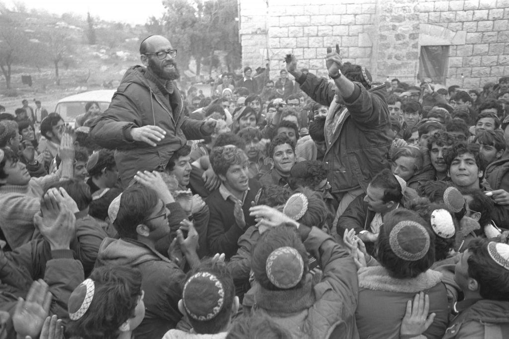 Rabbi Moshe Levinger (L), Gush Emunim leader Hanan Porat (R) and fellow activists, celebrate the government's 1975 agreement which allows all settlers to relocate to a military camp near the Arab village of Sebastia and additional locations in the Samaria region. (Moshe Milner)
