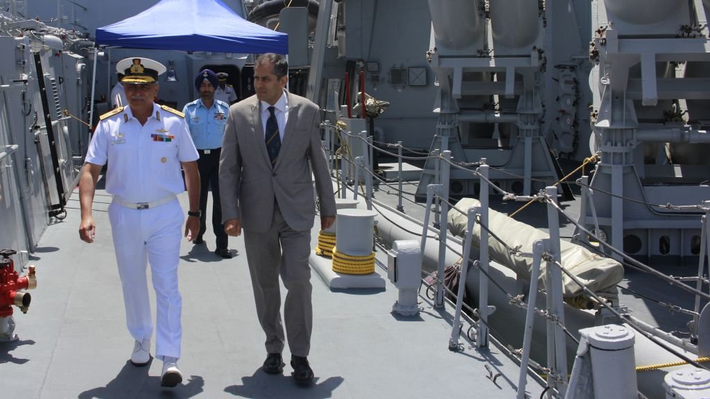 Indian Ambassador Pavan Kapoor and Rear Admiral RB Pandit walk the deck of the INS Trishul, docked in Haifa as part of an official visit by the Indian Navy on May 10, 2017. (Judah Ari Gross/Times of Israel)