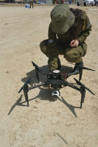 A soldier from the Army Fighting Intelligence Unit inspects a new drone bought by the military for the Compagny commanders. (Credit: Screenshot / Israeli Army Spokesperson Unit)