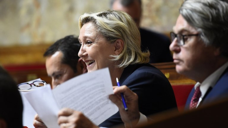 French far-right National Front party MP Marine Le Pen (C) reacts during a debate on July 10, 2017, at the French National Assembly in Paris. (AFP Photo/Bertrand Guay)