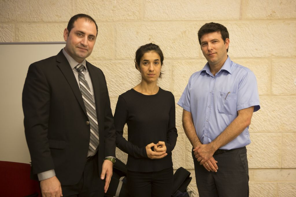 Yazidi activists Haider Elias, Nadia Murad, with Dr. Eyal Kaminka, director of the International School of Holocaust Studies at Yad Vashem. (courtesy/IsraAID)