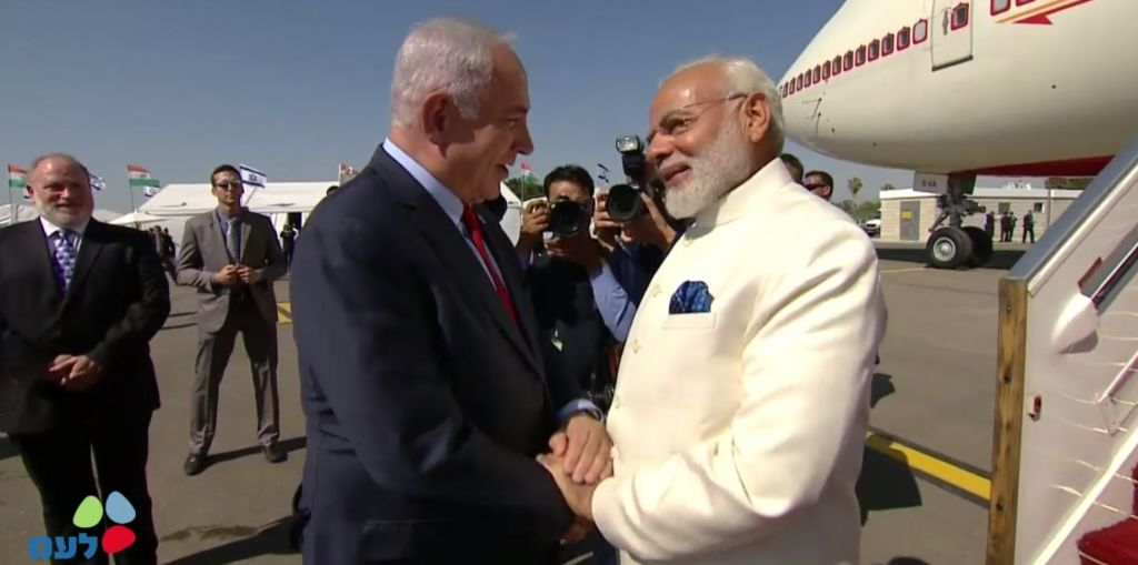 Prime Minister Benjamin Netanyahu, left, and Indian Premier Narendra Modi at Ben Gurion Airport on July 4, 2017. (screen capture: GPO)