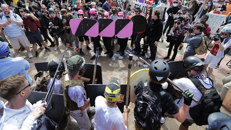 "Battle lines form between white nationalists and antifa protesters at the entrance to Emancipation Park during the ""Unite the Right"" rally August 12, 2017 in Charlottesville, Virginia. (Chip Somodevilla/Getty Images/AFP)"