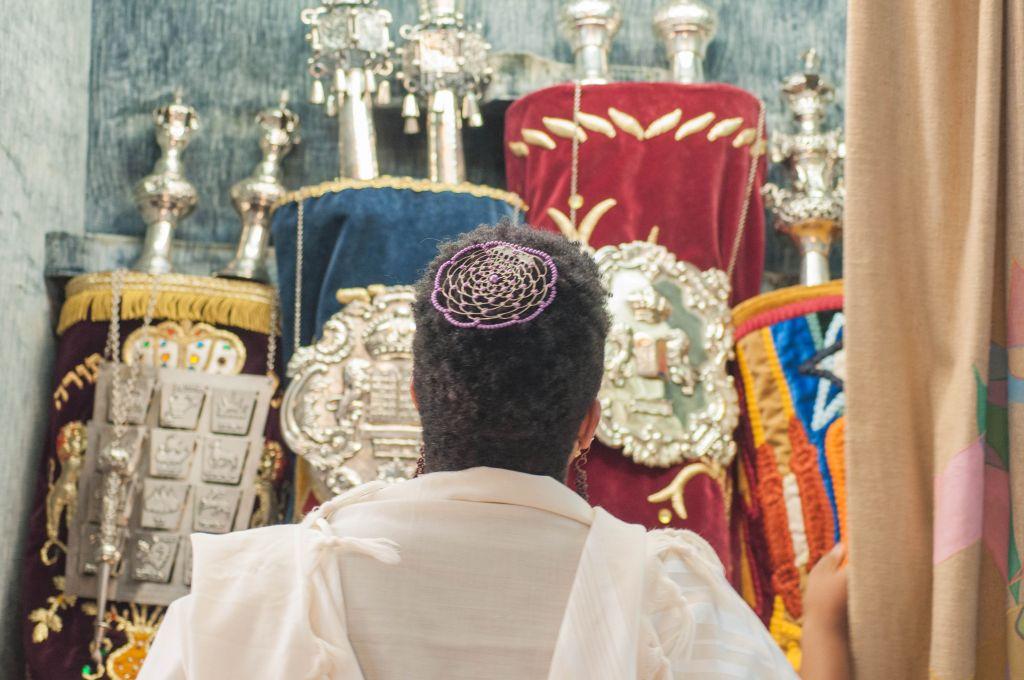 Rabbi Tiferet Berenbaum in front of the holy ark. (Courtesy)