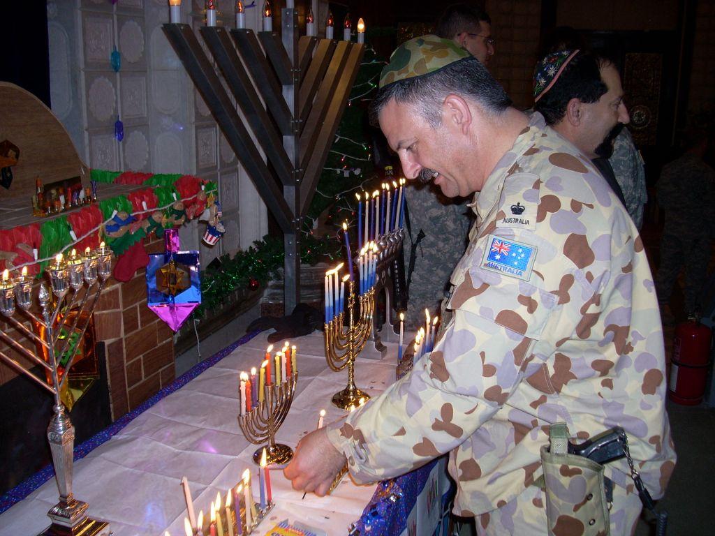 Major Scott Leonard lighting a Chanukiah. (Courtesy Scott Leonard)