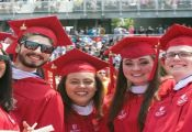 Students from the Stony Brook University School of Journalism celebrate at the school's commencement on May 20, 2016. Photo by Kayla Shults.