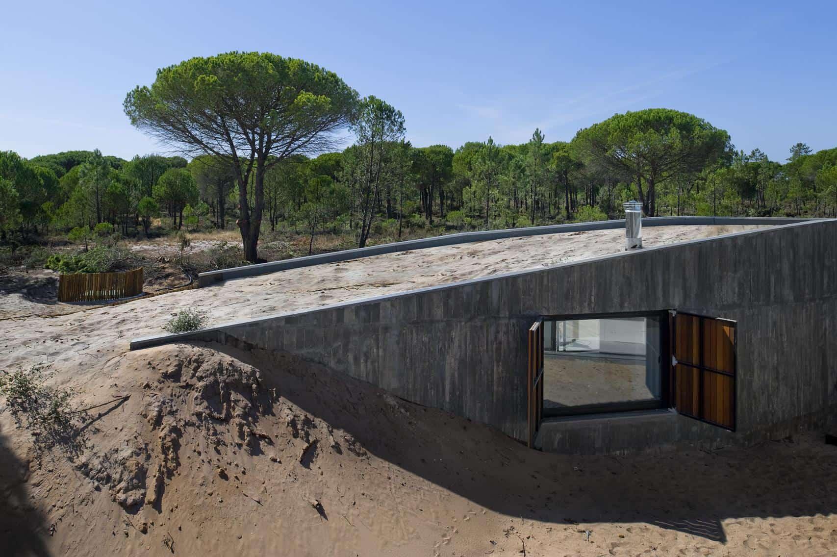 Concrete House Buried Under Artificial Sand Dunes
