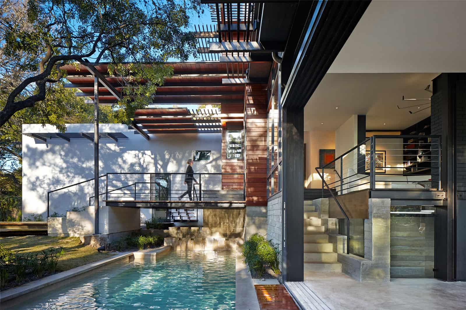 Rancher Morphed Into Sustainable 2 Storey House With Bridged Pool