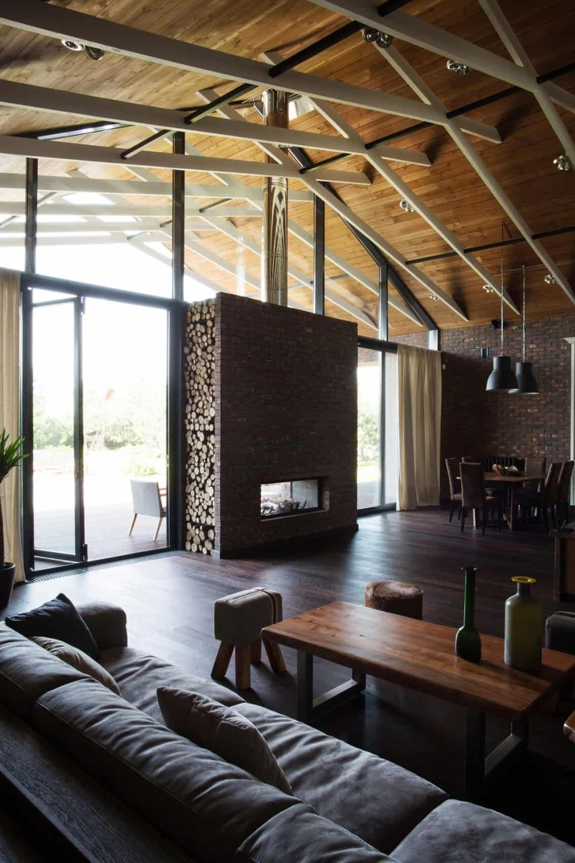 Exposed Trusses Create Artistic Composition Within Brick