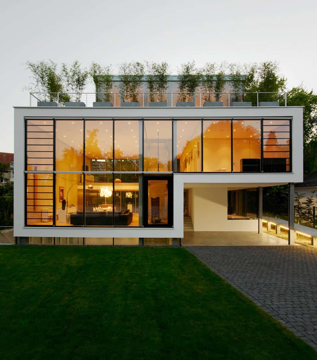 Energy Optimized House With Roof Terrace Louver Windows