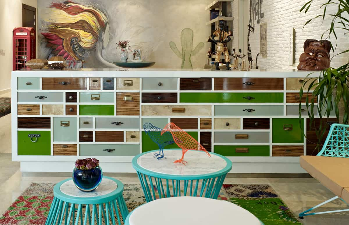 Eclectic Interior Splashed In Colorful Furniture And Art