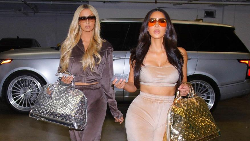 Kim Kardashian learned from the best: Paris Hilton's former assistant in her tracksuit collection, along with the original.