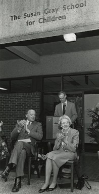Former Vanderbilt Chancellor Joe B. Wyatt (left) and Peabody College Dean Willis Hawley (standing) honor Susan Gray for her life's work with the naming of the Susan Gray School for Children in 1986.