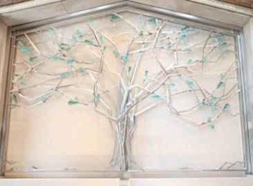 The focal point upon entering is a commissioned tree sculpture and water wall. (Susan Urmy/Vanderbilt)