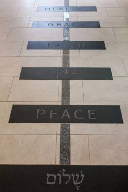 A blue granite pathway is intersected by 12 black granite tiles engraved with words that exemplify the Divinity School's mission. (Anne Rayner/Vanderbilt)