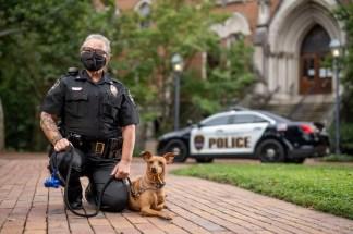 Vanderbilt Police Sergeant Cheryl Bradley with K9 Levi outside Kirkland Hall.