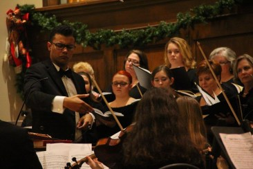 """Crocker conducting the Willow Oak Chorale and Orchestra in their annual performance of Handel's """"Messiah"""" in his hometown of Springfield, Tennessee."""