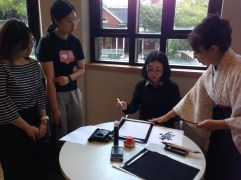 Chen attending a calligraphy workshop with friends on campus before COVID.