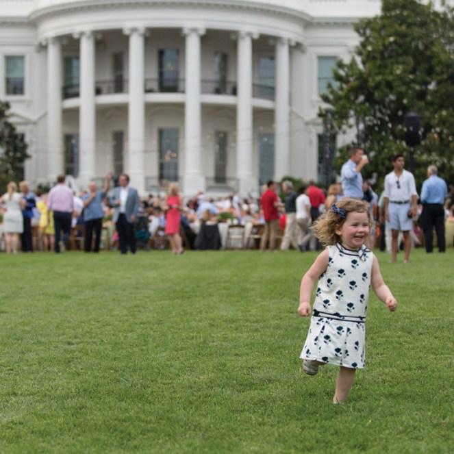 photo of girl playing on White House lawn