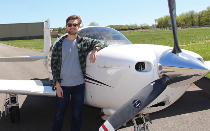 photo of Logan Tinley with his airplane