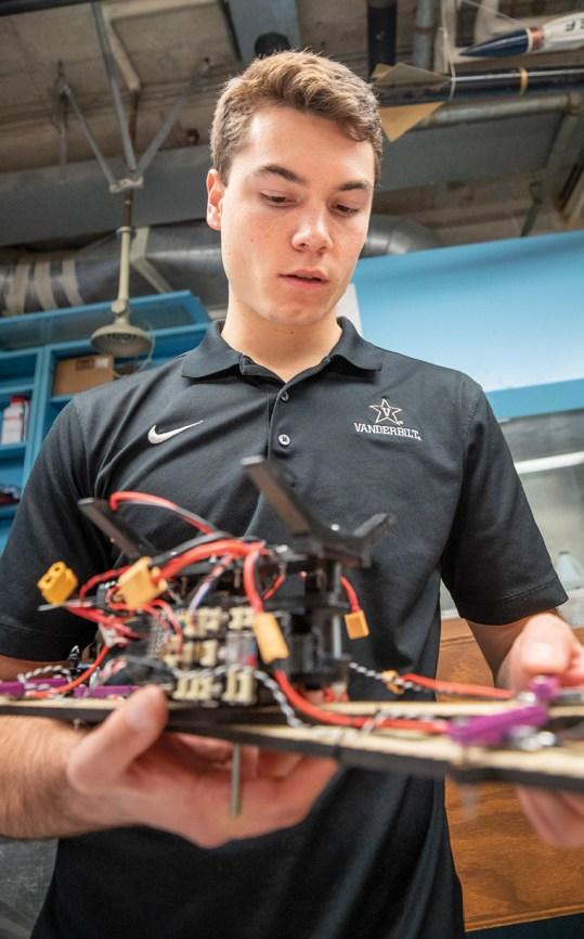 Mark Scherer assembles the 2019 UAV prototype for laboratory scale integrated testing. (Vanderbilt University/John Russell)