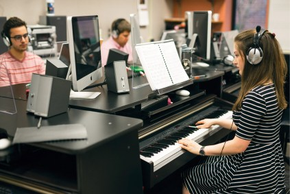 """Abbey in Keyboard Harmony—a required course for all music majors. """"The keyboard is a very important tool for setting the music visually on the page and in your ear,"""" she says."""