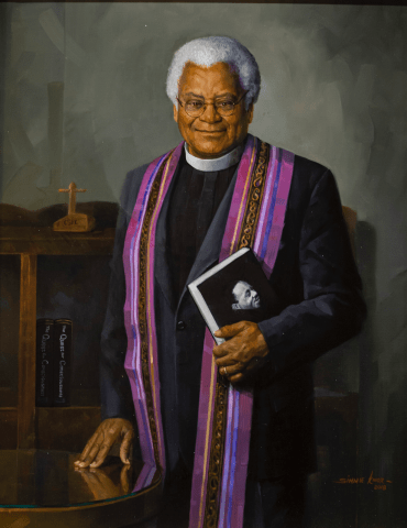 Portrait of the Rev. James Lawson holding a book