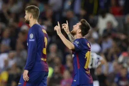 e2d4e82c9a5 Barcelona s forward from Argentina Lionel Messi (R) celebrates past  Barcelona s defender from Spain Gerard Pique after scoring during the UEFA  Champions ...