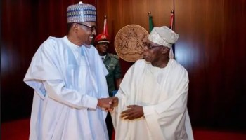 President Buhari exchanges pleasantries with former President Obasanjo, ahead of the National Council of State Meeting at the State House,
