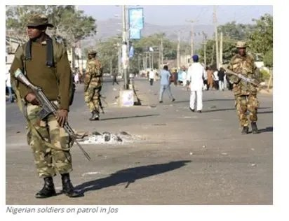 Nigerian soldiers on patrol in Jos, jihadists