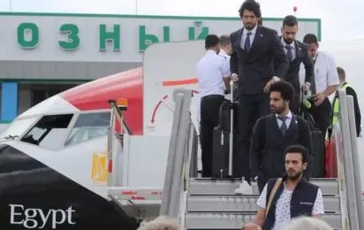 67a432bbf Egyptian national team football player and Liverpool s star striker Mohamed  Salah (C) disembarks from the plane with his team at Grozny International  ...