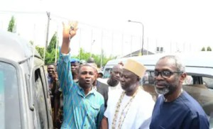 •From left: One of the beneficiaries of Gbaja Ride, Mr Shola Alli; Onikate of Ikate, Surulere, Oba Lateef Adams and the Majority Leader of the House of Representatives, Femi Gbajabiamila at the unveiling of 30 new buses, 25 tricycles and 160 motorcycles under the GbajaRide Transportation Initiative in Surulere 1, Federal Constituency, Lagos last Friday. Photo: Office of the House Leader