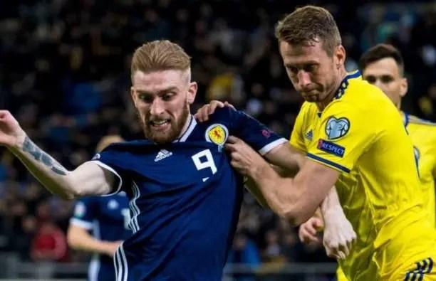 edec62d0412 Scotland's Oli McBurnie (left) competes with Kazakhstan's Serhiy Malyi (Sky  Sports)