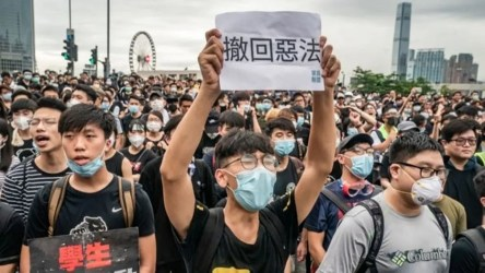 Hundreds of protesters blocked Hong Kong's police headquarters Friday evening.