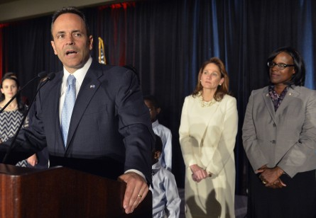 With his wife Glenna Bevin, center, and Lieutenant Governor-elect Jenean Hampton, right, looking on, Kentucky Republican Governor-elect Matt Bevin, speaks to his supporters at the Republican Party victory celebration, Tuesday, Nov. 3, 2015, in Louisville, Ky. (AP Photo/Timothy D. Easley)