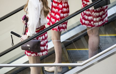 UNITED STATES - MARCH 3: Women in matching red elephant skirts ride the escalator at the American Conservative Union's CPAC conference at National Harbor in Oxon Hill, Md., on Thursday, March 3, 2016. (Photo By Bill Clark/CQ Roll Call)