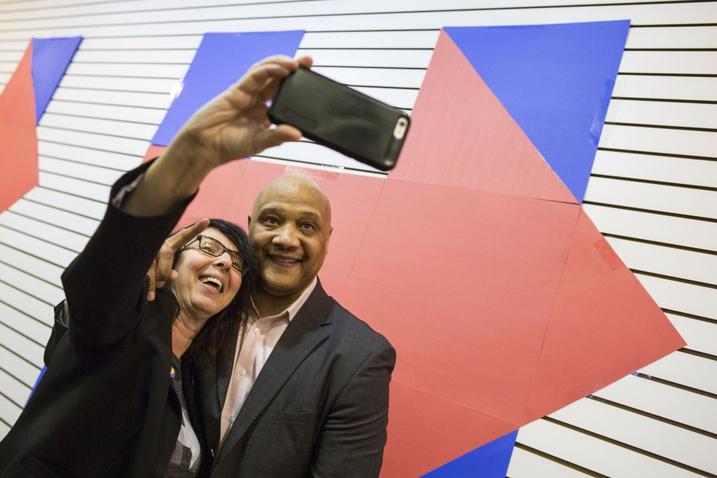 UNITED STATES - APRIL 5 - Iris Goldfeder, from Lafayette, Ind., takes a selfie with Rep. André Carson, D-Ind., during a campaign headquarters opening for Democratic presidential candidate Hillary Clinton, in Indianapolis, Ind., on Tuesday, April 5, 2016. (Photo By Al Drago/CQ Roll Call)