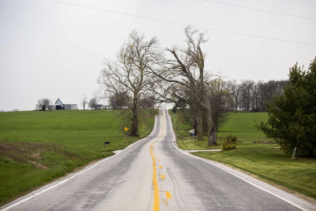 UNITED STATES - APRIL 6 - A country rods winds past two trees as storm clouds roll in near Salem, Ind., Wednesday, April 6, 2016. (Photo By Al Drago/CQ Roll Call)
