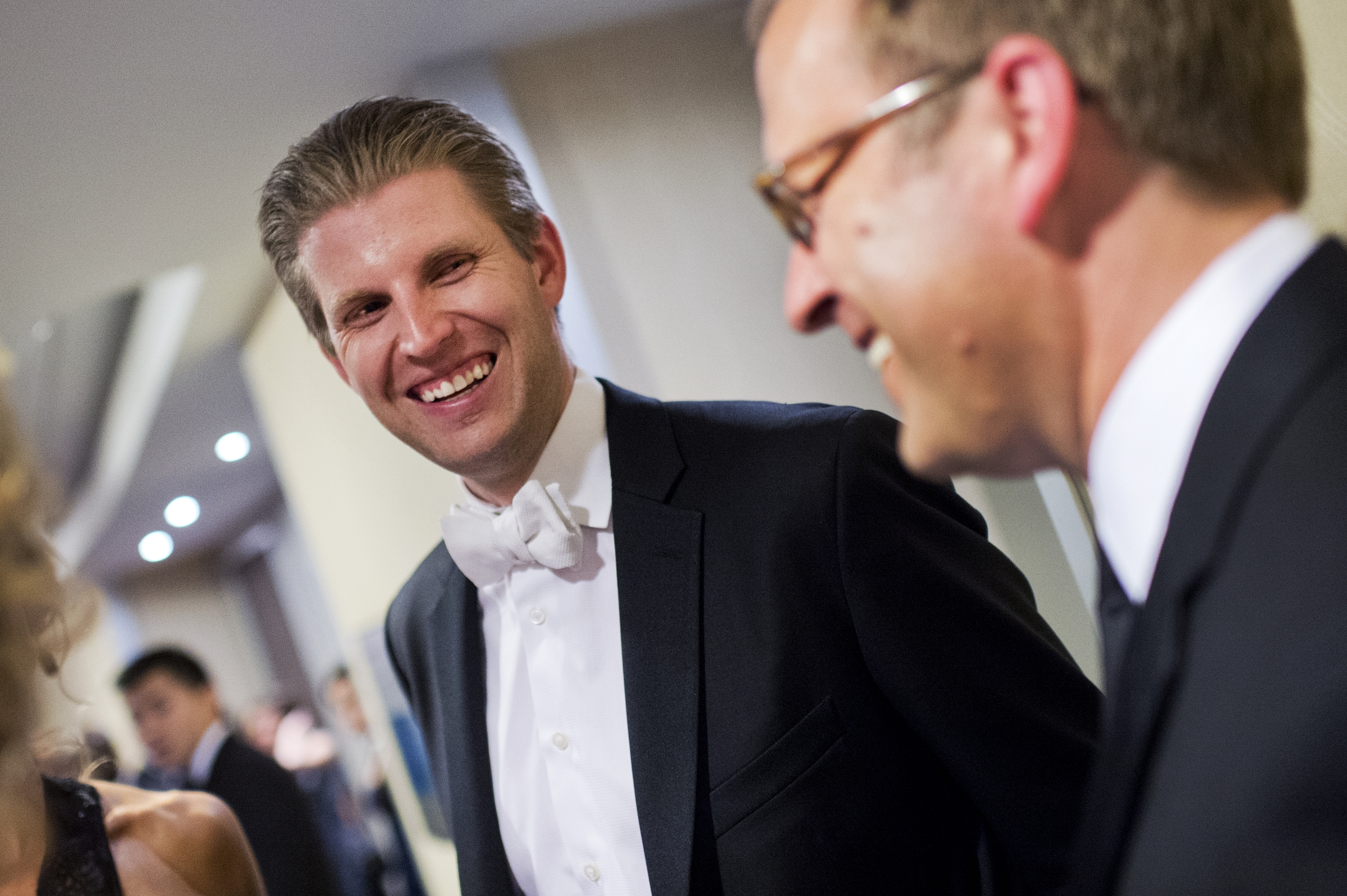 Eric Trump, center, son of Republican front-runner Donald Trump, talks with Jonathan Karl of ABC News outside the Yahoo/ABC News party on Saturday. (Photo By Tom Williams/CQ Roll Call)