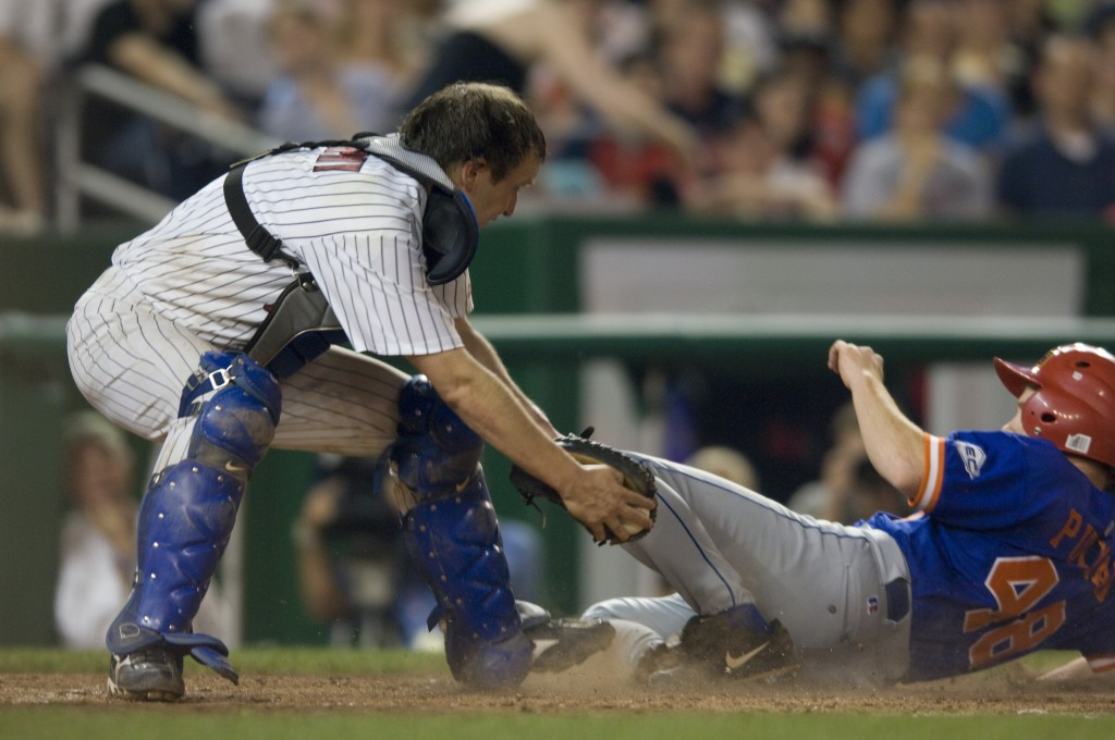 Democrats' catcher Sen. Christopher S. Murphy of Connecticut applies a late tag to Republican Rep. Adam Putnam of Florida at home plate during the Roll Call Congressional Baseball Game at Nationals Stadium in 2008. (CQ Roll Call File Photo)