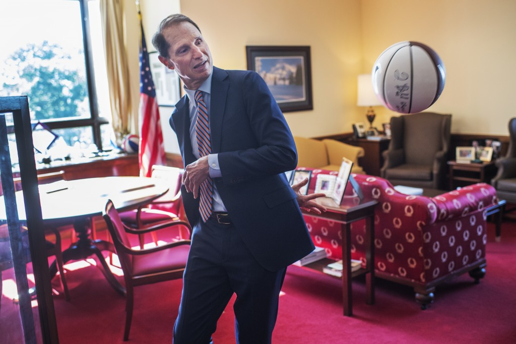 UNITED STATES - JUNE 8: Sen. Ron Wyden, D-Ore., tosses a basketball during an interview with Roll Call in his Dirksen Building office, June 8, 2016. (Photo By Tom Williams/CQ Roll Call)