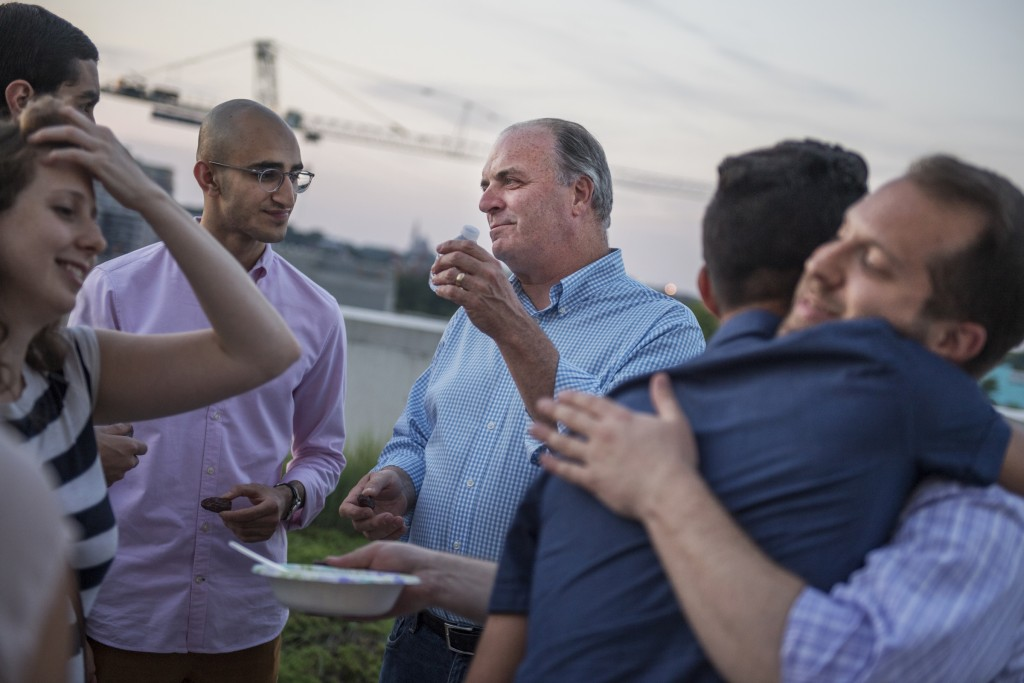 Michigan Rep. Dan Kildee, center, attends an iftar dinner on a roof deck in Northeast, D.C., for his staff and others who participated in fasting for Ramadan. (Tom Williams/CQ Roll Call)