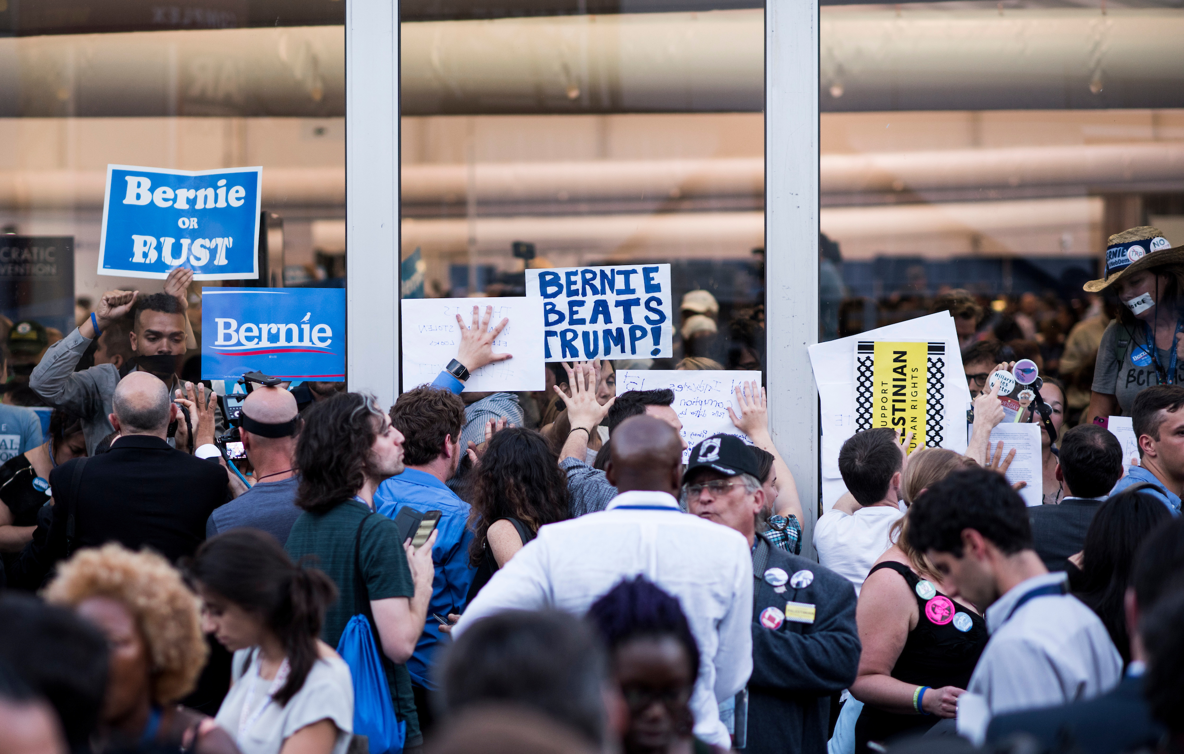 Bernie Sanders delegates and supporters stage a walk out and protest at the media tents outside the Democratic National Convention in Philadelphia on Tuesday, July 26, 2016. (Bill Clark/CQ Roll Call)