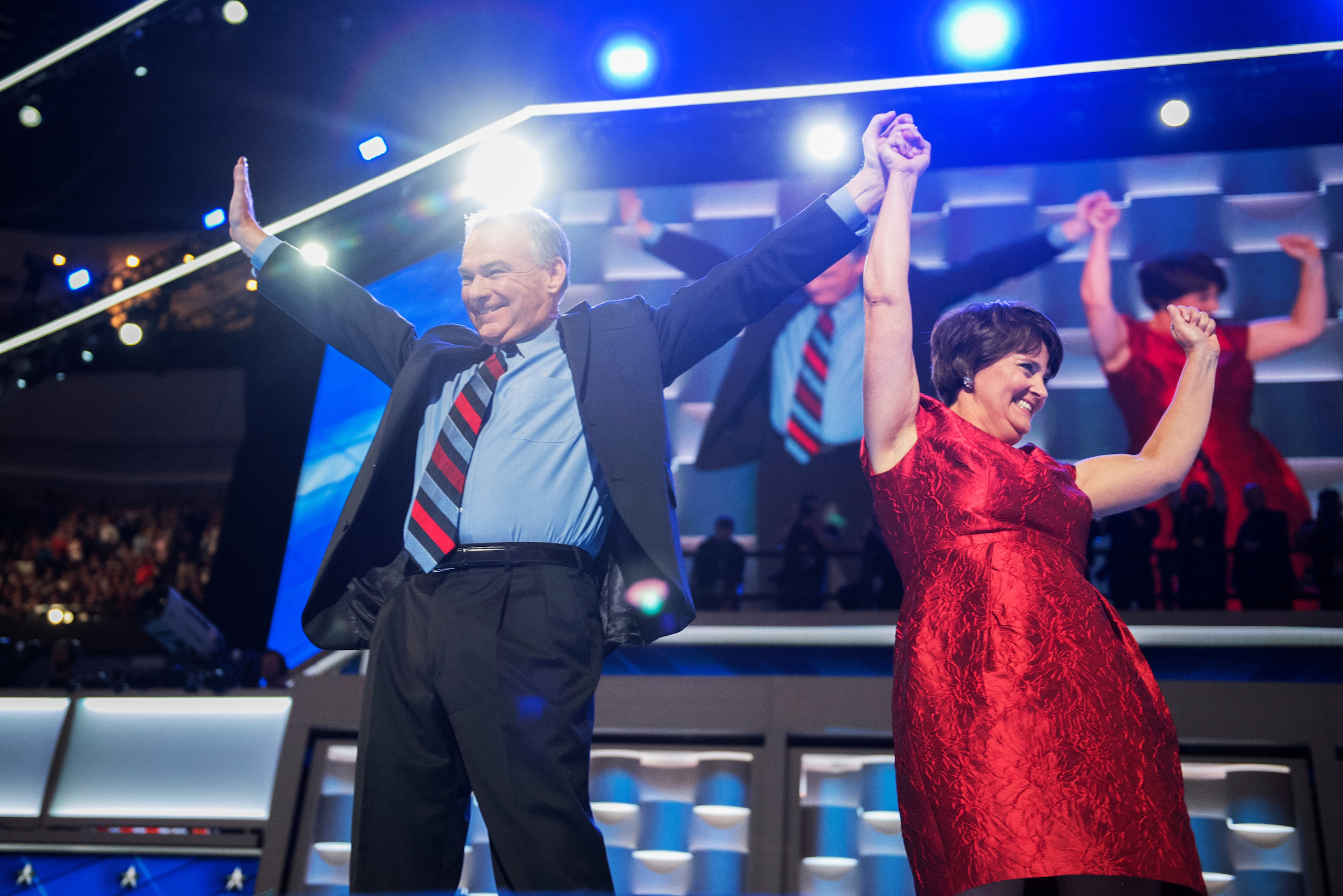 Democratic vice presidential nominee Tim Kaine and his wife Anne Holton acknowledge the crowd after Kaine addressed the convention Wednesday. (Tom Williams/CQ Roll Call)