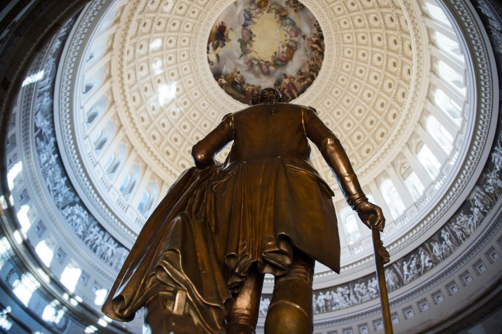The statue of George Washington stands in the newly restored U.S. Capitol Rotunda on Tuesday morning, Sept. 6, 2016, as the area is reopened to the public following the restoration of the iconic space. (Bill Clark/CQ Roll Call)