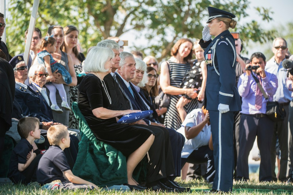 Air Force Cpt. Jennifer Lee, salutes after presenting an American Flag to Terry Harmon, daughter of Women Airforce Service Pilot (WASP) Elaine Harmon on Sept. 7, 2016. (Tom Williams/CQ Roll Call)