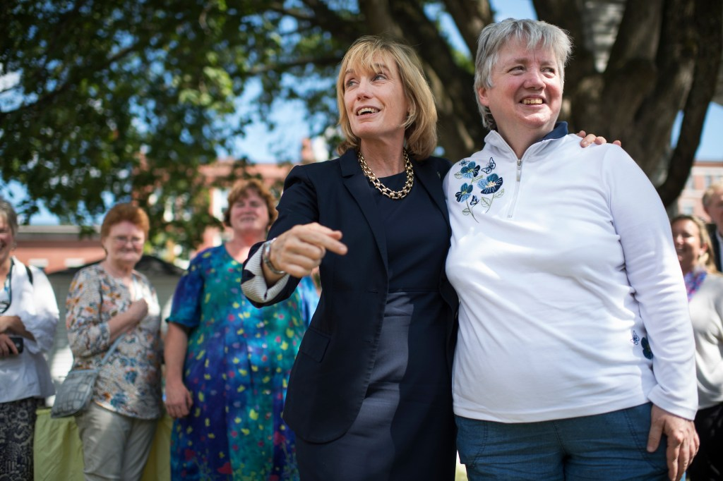 New Hampshire Gov. Maggie Hassan, left, Democratic candidate for Senate, greets Roberta Gallant during an event in the state capital Concord on Friday. (Tom Williams/CQ Roll Call)