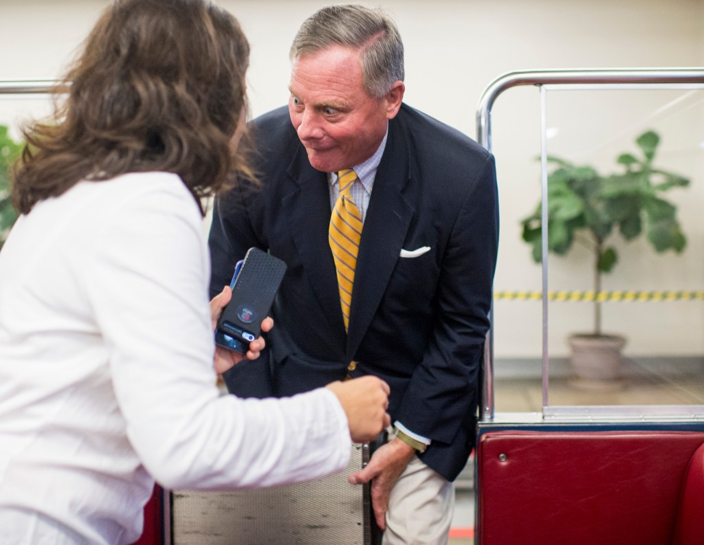 The door of the Senate Subway train to the Russell Building closes on North Carolina Sen. Richard M. Burr's leg as he leaves the Capitol following a vote on Thursday. (Bill Clark/CQ Roll Call)